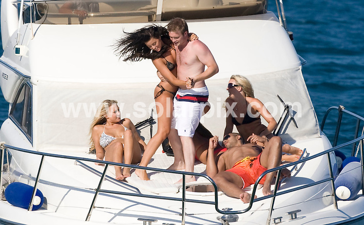 **ALL ROUND EXCLUSIVE  PICTURES FROM SOLARPIX.COM**.**WORLDWIDE SYNDICATION RIGHTS**.Winner of Dancing on Ice and Hollyoaks star, Chris Fountain on holiday in Marbella this weekend. .The young actor took to the seas with a friend and a bevy of beauties on board a luxury motor launch. As the party pulled back into port later in the day, Chris looked smitten, as he stood on the back of the boat, with one of the lovely ladies and admired the sunset while the pair sipped at glasses of bubbly. .JOB REF:      6946    AB1        DATE:  21.08.08.**MUST CREDIT SOLARPIX.COM OR DOUBLE FEE WILL BE CHARGED* *UNDER NO CIRCUMSTANCES IS THIS IMAGE TO BE REPRODUCED FOR ANY ONLINE EDITION WITHOUT PRIOR PERMISSION*