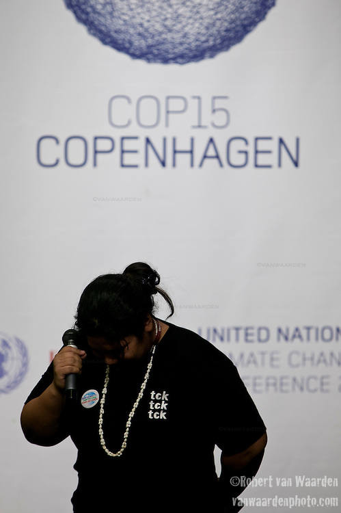 "Leah Wickham, from Fiji, breaks into tears on the opening day of the Copenhagen summit.  TckTckTck - an unprecedented alliance of civil society organisations - delivered its petition which more than 10 million people have signed, calling for world leaders to seal a fair, ambitious and binding climate deal at the talks. 15 young people from around the world held large scale ""building blocks"" which spell out ""10 million people expect a fair, ambitious and binding deal"" to show world leaders that all the elements required for an effective climate treaty are present. Young people from around the world handed over the petition to UNFCCC Executive Secretary Yvo de Boer and Danish Climate Minister and the President of COP15 Connie Hedegaard. Leah Wickham, from Fiji, spoke briefly on behalf of the 10 million people expecting a real deal at Copenhagen."