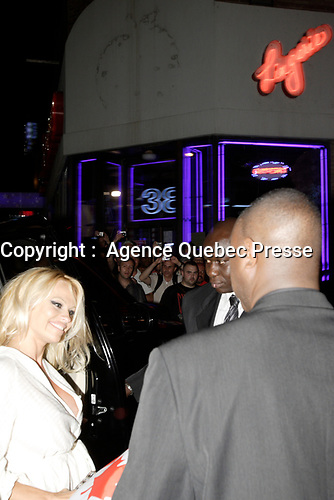 """Montreal (Qc) CANADA - June 7 2008-<br /> Canadian born """"actress"""" Pamela Anderson get out of a massive SUV, onto the red carpet of a club in Montreal club who paid her 100, 000 $ to host a  fashion contest.<br /> <br /> She refused all planned interview and photo op and managed to get the local press angry.<br /> One article in today (June 9) Journal de Montreal was very critical of the star attitude and wondered was star acted like this in Montreal and not in New-York or Los Angeles.<br /> <br /> <br /> Photo :   Pierre Roussel / AGENCE QUEBEC PRESSE"""