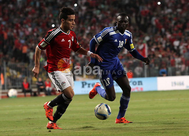 """Egypt's players compete against Chad players during their 2018 World Cup qualifying soccer match agaist Chad at Borg El Arab """"Army Stadium"""" in the Mediterranean city of Alexandria, north of Cairo, Egypt, November 17, 2015. Spectators will be watching the match after receiving approval from security for the first time in a long tim. Photo by Amr Sayed"""