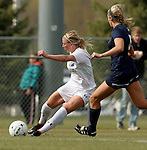 BROOKINGS, SD - OCTOBER 12: Dani Patterson #12 from South Dakota State chips a pass around Libby Schriver #5 from Oral Roberts University in the first half of their game Sunday afternoon at Fischback Soccer Field in Brookings. (Photo by Dave Eggen/Inertia)