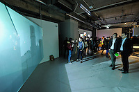 HONG KONG - MARCH 12:  Visitors look at animation 'Dilbar' by Apichatpong Weerasethakul and Chai Siris, as part of the exhibition 'Moving Images' organized by M+ organization on March 12, 2015 in Hong Kong, Hong Kong.  (Photo by Lucas Schifres/Getty Images)