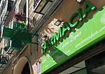 Green sign neon cross Farmacia pharmacy shop, Madrid city centre, Spain