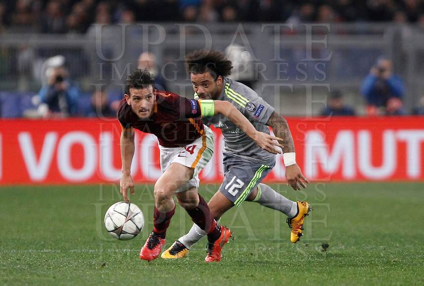 Calcio, andata degli ottavi di finale di Champions League: Roma vs Real Madrid. Roma, stadio Olimpico, 17 febbraio 2016.<br /> Roma's Alessandro Florenzi, left, is chased by Real Madrid's Marcelo during the first leg round of 16 Champions League football match between Roma and Real Madrid, at Rome's Olympic stadium, 17 February 2016.<br /> UPDATE IMAGES PRESS/Isabella Bonotto