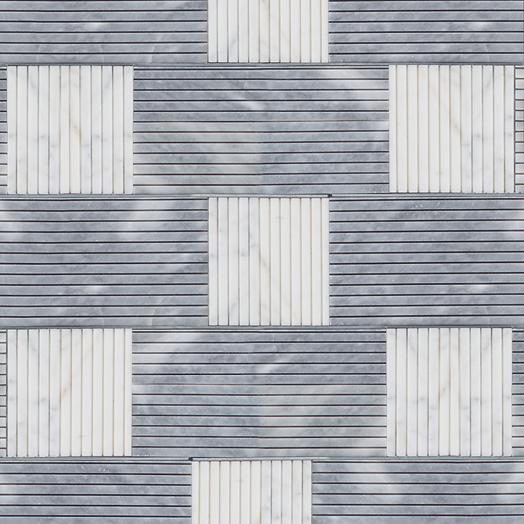 Kiawah Kente Grand, a hand-cut stone mosaic, shown in honed Allure, honed Calacatta, and zinc liners. Designed by Joni Vanderslice as part of the J. Banks Collection for New Ravenna.