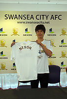 Friday 02 November 2012<br /> Pictured: Footballer Ki Sung Yueng.<br /> Re: Sponsorship deal between Korean gaming firm Nexon and Swansea City FC at the Liberty Stadium, south Wales.