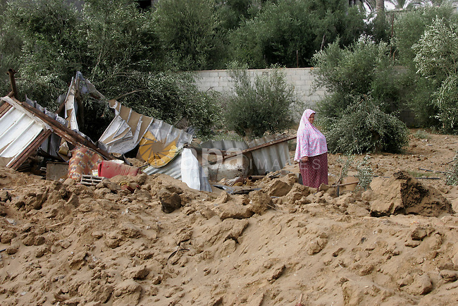 Palestinians gather around the remains of a Chicken farm, which witnesses said was destroyed in an Israeli air strike before a 72-hour truce, in Rafah in the southern Gaza Strip August 11, 2014. Israeli negotiators were due in Cairo on Monday for talks on ending a month-old Gaza war with Palestinian militants, an Israeli government official said, after a new 72-hour truce brokered by Egypt appeared to be holding. Photo by Abed Rahim Khatib
