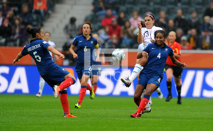 Alex Morgan (C) of team USA and Laura Georges (r) and Ophelie Meilleroux of team France during the FIFA Women's World Cup at the FIFA Stadium in Moenchengladbach, Germany on July 13th, 2011.