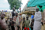 Dinka women and children live in a large camp with thousands of cows near Rumbek, South Sudan.
