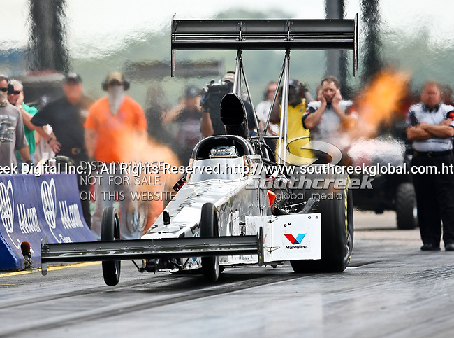 Bob Vandergriff Jr. #12, driver for C & J Energy Service's Top Fuel Dragster makes a run at the O'Reilly Fall Nationals held at the Texas Motorplex in  Ennis, Texas.