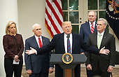 United States President Donald J. Trump makes a statement following his meeting with Democratic leaders in the Situation Room of the White House in Washington, DC in an effort to break the political impasse on border security and reopen the federal government on Friday, January 4, 2018.  The President also took questions from reporters.  Looking on, from left to right, are: US Vice President Mike Pence, US House Minority Whip Steve Scalise (Republican of Louisiana), and US House Minority Leader Kevin McCarthy (Republican of California).<br /> Credit: Ron Sachs / CNP