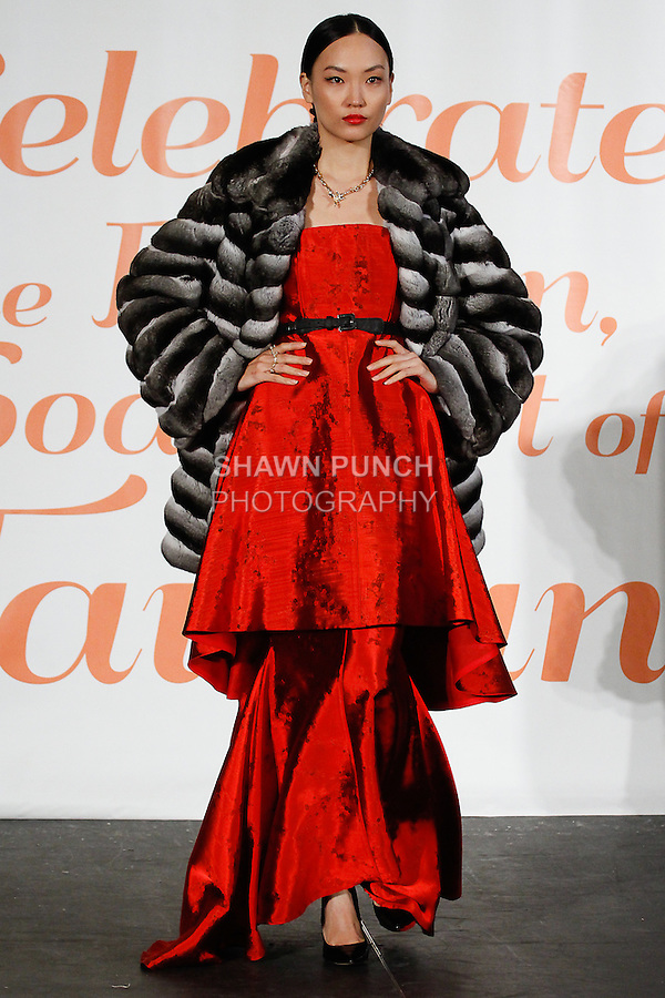 Model walks runway in an outfit from the Malan Breton Spring 2014 collection, during the Celebrate Taiwan @ Grand Central Terminal event on September 28, 2013.