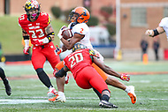 College Park, MD - October 27, 2018: Maryland Terrapins defensive back Antwaine Richardson (20) tackles Illinois Fighting Illini running back Reggie Corbin (2) during the game between Illinois and Maryland at  Capital One Field at Maryland Stadium in College Park, MD.  (Photo by Elliott Brown/Media Images International)