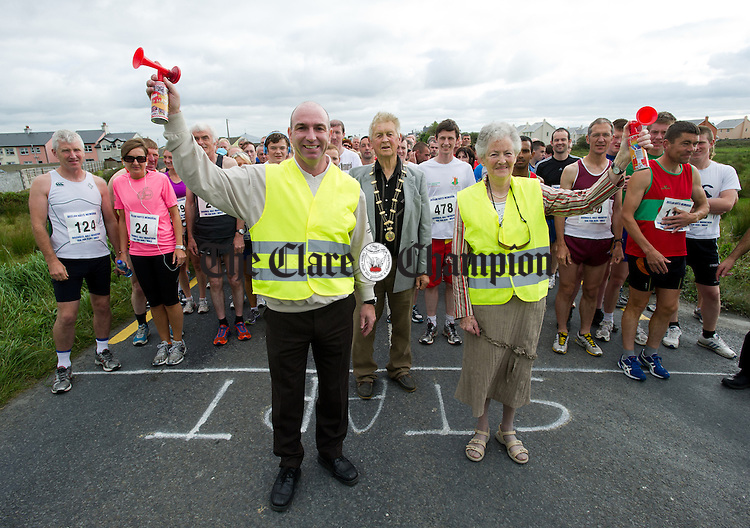 Declan Hayes' mother Betty Hayes with Kilkenny hurling legend DJ Carey before starting the Declan Hayes Memorial Doonbeg Half Marathon/10K Fun Run and Walk. Photograph by John Kelly.