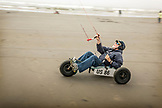USA, Washington State, Long Beach Peninsula, man in a wheeled go kart is pulled by his kite at the International Kite Festival