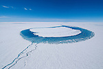 Greenland lake formed atop the ice sheet during spring and summer when sunlight melts ice and snow.