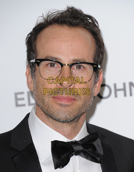 JASON LEE .19th Annual Elton John AIDS Foundation Academy Awards Viewing Party held at The Pacific Design Center, West Hollywood, California, USA..February 27th, 2011.headshot portrait bow tie stubble facial hair black white glasses .CAP/RKE/DVS.©DVS/RockinExposures/Capital Pictures.