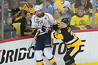 May 29, 2017: Pittsburgh Penguins defenseman Olli Maatta (3) checks Nashville Predators left wing James Neal (18)   during game one of the National Hockey League Stanley Cup Finals between the Nashville Predators  and the Pittsburgh Penguins, held at PPG Paints Arena, in Pittsburgh, PA. Pittsburgh defeats Nashville 5-3 in regulation time.  Eric Canha/CSM