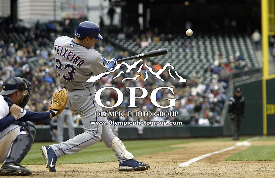 10 April 2005:  Texas Rangers first baseman Mark Teixeira hits a line drive against the Seattle Mariners at Safeco field in Seattle, WA.