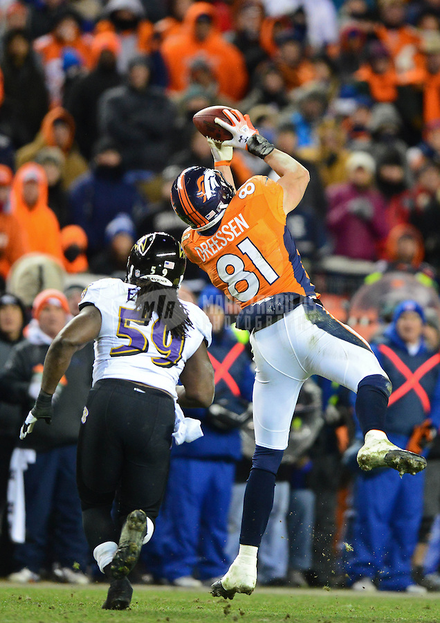Jan 12, 2013; Denver, CO, USA; Denver Broncos tight end Joel Dreessen (81) catches a pass against the Baltimore Ravens during the AFC divisional round playoff game at Sports Authority Field.  Mandatory Credit: Mark J. Rebilas-