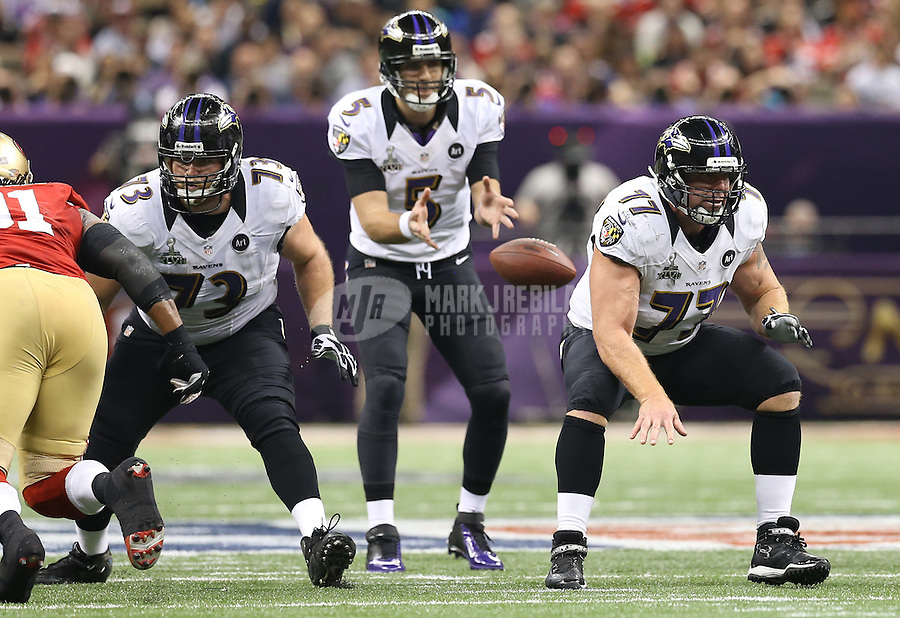 Feb 3, 2013; New Orleans, LA, USA; Baltimore Ravens guard Marshal Yanda (73) and center Matt Birk (77) block for quarterback Joe Flacco (5) against the San Francisco 49ers in Super Bowl XLVII at the Mercedes-Benz Superdome. Mandatory Credit: Mark J. Rebilas-