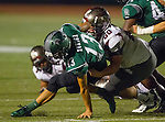 Torrance, CA 10/09/15 - Gabe Zuniga (South #13) and Thomas Craig (Torrance #60) in action during the Torrance vs South High varsity football game.  South defeated Torrance 24-21.