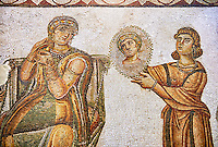 5th century Roman mosaic panel of the ceremonial dressing of a lady. The lady was of the landed gentry from inland Carthage. She is sitting on a high backed armchair and is surrounded by two ornatrix, maids, whoa re helping her to apply make up and style her hair. Items related to bathing and grooming are depicted on the background of the mosaic. The maid hold a mirror for the lady in which we see her reflection The scene is an allegory of the myth of 'Venus at her toilet'.<br /> <br /> From the floor of the changing room of the private baths of the Sidi Ghraib villa, Borj El Amre region, Tunisia. The Bardo Museum, Tunis, Tunisia.