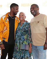 LOS ANGELES - JUL 27:  Michael B. Jordan, Donna Jordan, Michael A. Jordan at the 3rd Annual MBJAM19 at the Dave & Busters on July 27, 2019 in Los Angeles, CA