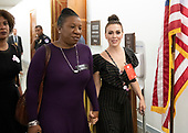 Actress Alyssa Milano, right holds hands with an unidentified person as she walks in the hallway during a break in the testimony of Dr. Christine Blasey Ford  before the US Senate Committee on the Judiciary on the nomination of Judge Brett Kavanaugh to be Associate Justice of the US Supreme Court to replace the retiring Justice Anthony Kennedy on Capitol Hill in Washington, DC on Thursday, September 27, 2018.   <br /> Credit: Ron Sachs / CNP<br /> (RESTRICTION: NO New York or New Jersey Newspapers or newspapers within a 75 mile radius of New York City)