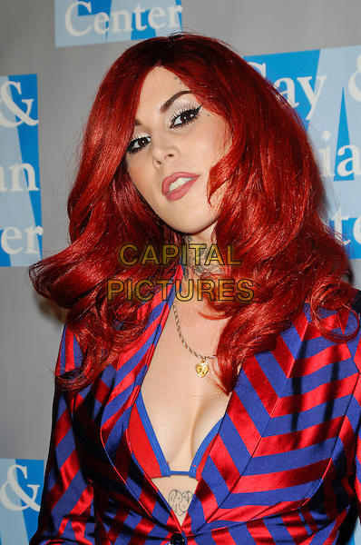 """KAT VON D .Arriving at the L.A. Gay & Lesbian Center's """"An Evening With Women"""" Celebrating Art, Music and Equality at the Beverly Hilton Hotel in Beverly Hills, California, USA, May 1st, 2010..portrait headshot red and blue striped suit jacket bra cleavage dyed hair tattoos tattoo make-up.CAP/ROT.©Lee Roth/Capital Pictures"""