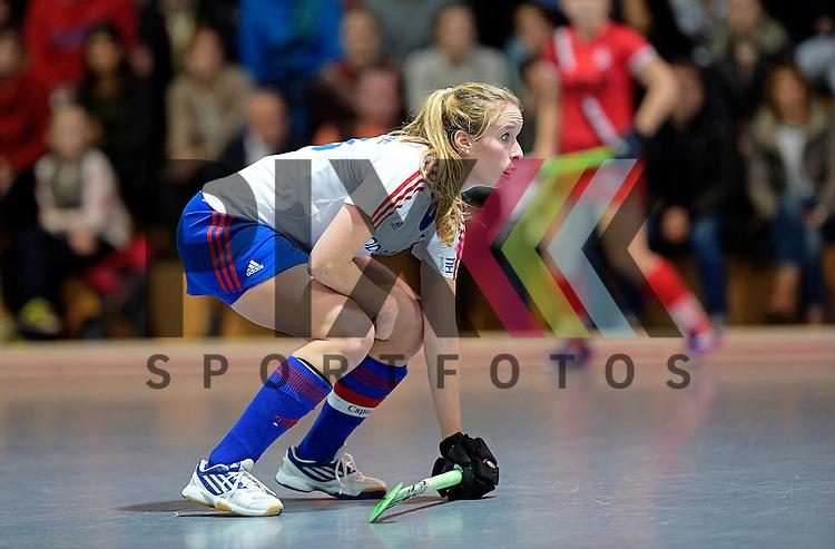GER - Mannheim, Germany, December 05: During the 1. Bundesliga Sued Damen indoor hockey match between Mannheimer HC (white) and TSV Mannheim (red) on December 5, 2015 at Irma-Roechling-Halle in Mannheim, Germany. Final score 7-1 (HT 5-0).  Greta Lyer #10 of Mannheimer HC<br /> <br /> Foto &copy; PIX-Sportfotos *** Foto ist honorarpflichtig! *** Auf Anfrage in hoeherer Qualitaet/Aufloesung. Belegexemplar erbeten. Veroeffentlichung ausschliesslich fuer journalistisch-publizistische Zwecke. For editorial use only.