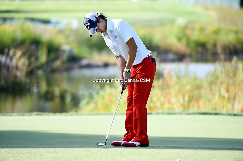 August 29, 2014 -  Norton, Mass. -  Ryo Ishikawa putts on the 16th green during the first round of the PGA Deutsche Bank Championship held at the Tournament Players Club in Norton Massachusetts. Eric Canha/CSM