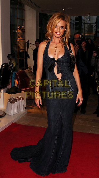 HEATHER GRAHAM.Diesel - store launch party, Diesel, 130 New Bond Street, London, UK..May 18th, 2006.Ref: CAN.full length denim jeans jean dress black plunging neckline cleavage ribbon .www.capitalpictures.com.sales@capitalpictures.com.© Capital Pictures.