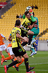 Wellington Phoenix' Dylan Fox and Brisbane&rsquo;s Jamie Young in action during the A League - Wellington Phoenix v Brisbane Roar FC at Westpac Stadium, Wellington, New Zealand on Sunday 25 March 2018.<br /> Photo by Masanori Udagawa. <br /> www.photowellington.photoshelter.com