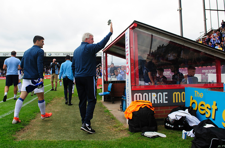 Sheffield Wednesday's manager Steve Bruce waves to the fans prior to the game<br /> <br /> Photographer Chris Vaughan/CameraSport<br /> <br /> Football Pre-Season Friendly - Lincoln City v Sheffield Wednesday - Saturday July 13th 2019 - Sincil Bank - Lincoln<br /> <br /> World Copyright © 2019 CameraSport. All rights reserved. 43 Linden Ave. Countesthorpe. Leicester. England. LE8 5PG - Tel: +44 (0) 116 277 4147 - admin@camerasport.com - www.camerasport.com