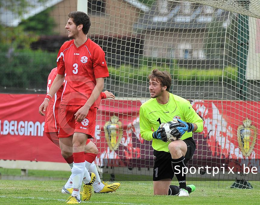 Scotland U19 - Georgia U19 : Gabriel Tebidze stops the penalty and celebrates this with his teammates.foto DAVID CATRY / Nikonpro.be