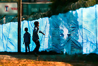 Pictured: Children play at the camp Friday 26 February 2016<br /> Re: Hundreds of refugees have been given temporary shelter at the Stefanakis Army Camp in the Schisto area of Athens, Greece.