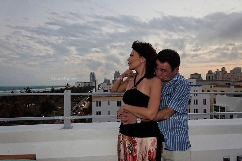 Iroda Salomova and Alisher Shadibekov on the rooftop of the Clevelander Hotel looking down Ocean Avenue at dusk.