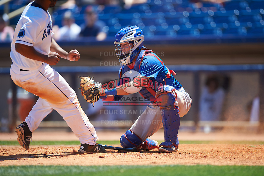 South Bend Cubs catcher P.J. Higgins (7) tags out Juan De La Cruz (23) attempting to score a run during a game against the Lake County Captains on July 27, 2016 at Classic Park in Eastlake, Ohio.  Lake County defeated South Bend 5-4.  (Mike Janes/Four Seam Images)