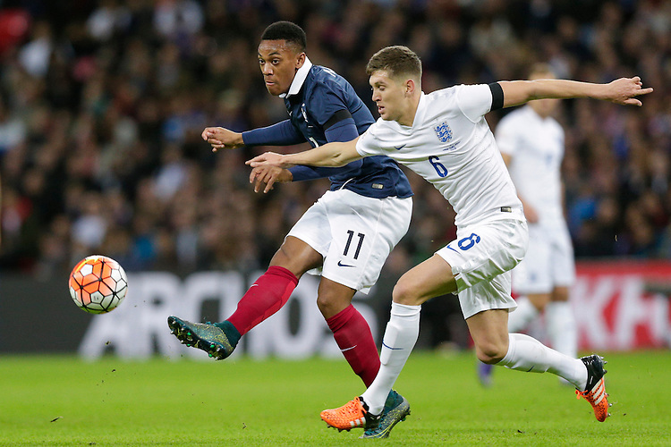 France&rsquo;s Anthony Martial under pressure from England&rsquo;s John Stones<br /> <br /> Photographer Craig Mercer/CameraSport<br /> <br /> Football International - England v France - Tuesday 17th November 2015 - Wembley Stadium - London<br /> <br /> &copy; CameraSport - 43 Linden Ave. Countesthorpe. Leicester. England. LE8 5PG - Tel: +44 (0) 116 277 4147 - admin@camerasport.com - www.camerasport.com
