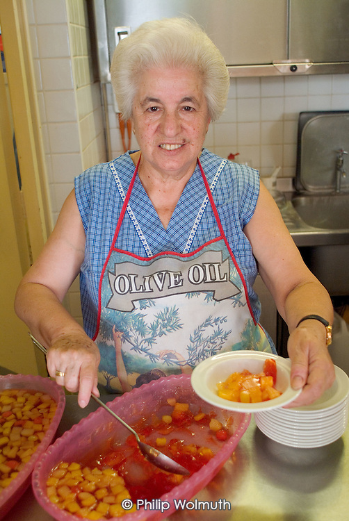Maria Torres serves lunch at the Church Street Drop In Centre for the elderly in Paddington, London. She has volunteered at the centre for 20 years.