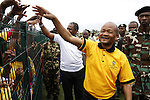 DURBAN - 6 October 2013 - Senzo Mchunu, the leader of the African National Congress in KwaZulu-Natal greets supporters at the party's first rally of the 2014 election campaign in the Princess Magogo Stadium in Durban's KwaMashu area. Immediately behind Mchunu (in white shirt) is Sibongiseni Dhlomo, the province's health MEC and leader of the party in the Durban region. Picture: Allied Picture Press/APP