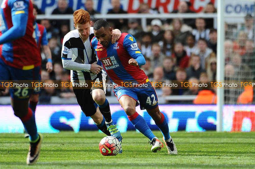 Jack Colback of Newcastle United pulls back Jason Puncheon of Crystal Palace during Newcastle United vs Crystal Palace, Barclays Premier League Football at St. James' Park on 30th April 2016