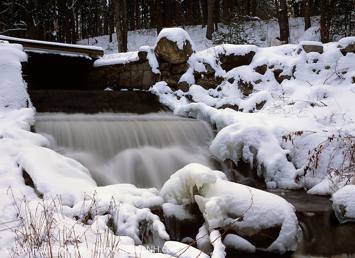 Brook surrounded by ice and snow. Located in Auburn, New Hampshire, USA.