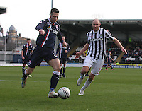 Mihael Kovacevic is pressured by Sam Parkin in the St Mirren v Ross County Clydesdale Bank Scottish Premier League match played at St Mirren Park, Paisley on 19.1.13.