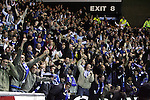 Rangers v St Johnstone....08.11.06   CIS Cup Quarter Final.Saints fans celebrates Steven Milne's opening goal..Picture by Graeme Hart..Copyright Perthshire Picture Agency.Tel: 01738 623350  Mobile: 07990 594431