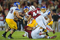 STANFORD, CA - AUGUST 31 2012: Chase Thomas and Ben Gardner sack David Fales during the Stanford Cardinal 20-17 win over San Jose State.