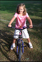 BNPS.co.uk (01202) 558833<br /> Picture: Collect/BNPS<br /> <br /> No hugs for brave Ella this Xmas...<br /> <br /> Ella aged 7 on her bike which she can no longer ride.<br /> <br /> Little Ella Murphy might look like a happy child but she is actually battling a rare condition that leaves her in such agony she can't cuddle her mother.<br /> <br /> Ella suffers from a neurological disease called Complex Regional Pain Disorder (CPRS) which affects one in 4,000 people per year.<br /> <br /> The condition means the schoolgirl is struck down by agonising pain in different parts of her body that can last for months at a time.<br /> <br /> Even the slightest touch of the tender area can cause a horrendous burning sensation, meaning her family cannot even hug her if her upper body is affected.