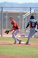 Cincinnati Reds first baseman Logan Uxa (80) waits for the throw as Yu-Cheng Chang (9) reaches the bag during an instructional league game against the Cleveland Indians on September 28, 2013 at Goodyear Training Complex in Goodyear, Arizona.  (Mike Janes/Four Seam Images)