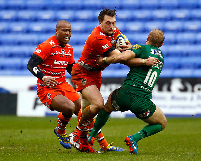 Leicester Tigers' George Catchpole is tackled by London Irish's Shane Geraghty<br /> <br /> Photographer Simon King/CameraSport<br /> <br /> Rugby Union - Aviva Premiership - London Irish v Leicester Tigers - Sunday 22nd February 2015 - Madejski Stadium - Reading<br /> <br /> &copy; CameraSport - 43 Linden Ave. Countesthorpe. Leicester. England. LE8 5PG - Tel: +44 (0) 116 277 4147 - admin@camerasport.com - www.camerasport.com
